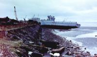 The hulk of ex-French Navy 'Sirius' Class minesweeper 'Vega' (P707) photographed beached on the east (North Shore) side of the East Pier at Troon Harbour, 26 November, 1982. The partially demolished vessel had been deliberately beached by the Shipbreakers on that side of the pier in the usual way in preparation for final breaking but had been blown further ashore and slewed round during a recent storm. 'Vega' and her sister 'Sagittaire' (P743) had arrived at Troon under tow of the Frank Pierce tug, 'Pullwell Lima', 22 April, 1982 (other sources quote 01 April as the arrival date for both vessels) and they lay at the East Pier for several months before breaking started as there were other vessels being dealt with first.<br><br>[Robert Blane&nbsp;26/11/1982]