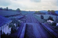 View south in failing light from the footbridge at Belses in 1974. For a similar view, in happier times, [see image 31873].<br><br>[Jim Scott //1974]