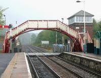 A misty morning in the Tyne Valley at Prudhoe on 7 May 2006. Platform view west over Station Road level crossing, looking towards Hexham and Carlisle.<br><br>[John Furnevel&nbsp;07/05/2006]