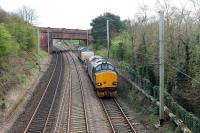 DRS 37218 hauls two flasks and 37609 from Heysham to Sellafield on 5th April 2017. The train is on the chord from Bare Lane to Hest Bank, running alongside the electrified main lines towards the junction at the level crossing.  <br><br>[Mark Bartlett&nbsp;05/04/2017]