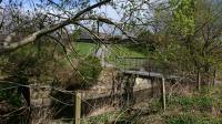 This is where the line crossed the Tarland burn just east of Aboyne station.<br> The bridge abutment looks like it has been partially removed and with subsequent development it makes the line difficult to locate.<br><br>[Alan Cormack&nbsp;14/04/2017]