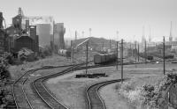 Thirty years ago.... looking west over Leith South Yard, still with grain, coal and pipes traffic. We were told (in 1980) that Leith South was the busiest freight terminal in Scotland. Don't think anything goes there now.<br><br>[Bill Roberton&nbsp;//1987]