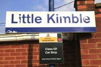 Close-up of Little Kimble station sign with DRA Reminder, August 2016.<br><br>[Ian Dinmore&nbsp;18/08/2016]