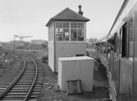 107 444 approaches Rosyth Dockyard signalbox with the 'Tay Forth Venturer' on 16 June 1984. In the left background is the Dockyard station with another DMU present.  The 'box is a NBR type 7, unusually of timber construction. Closed on 7 July 2008 it is listed Category-B.<br><br>[Bill Roberton&nbsp;16/06/1984]