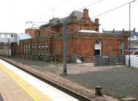 The classic lines of the main station building at Berwick, as rebuilt by the LNER in 1927, seen here in July 2005 from the island platform looking east over the site of the old south bay. Beyond the building is the main car park and station approach road, with the Castle Hotel just visible on Railway Street in the right background. For the front view [see image 4754].<br><br>[John Furnevel&nbsp;05/07/2005]