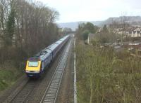 The 15.23 to Paddington (time from Bath Spa) is about to pass Oldfield park at speed. Photo' taken from road bridge adjacent to the S&D trackbed. [See image 58426]<br><br>[Ken Strachan&nbsp;05/03/2017]