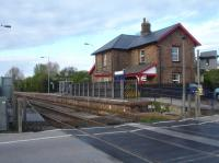Looking east across the level crossing dividing Bridlington Street, to left, and Bridlington Road to the former Hunmanby Station House sited behind the southbound platform for Bridlington, Beverley and Hull. The track is double from Seamer to just after the level crossing, and then single going forward to Bridlington.  <br><br>[David Pesterfield&nbsp;17/04/2017]
