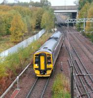 Autumn colours abound at Newcraighall North Junction on 16 October 2016 as ScotRail 158734 turns south west towards Shawfair with a morning Borders Railway service to Tweedbank shortly after leaving Newcraighall station. <br><br>[John Furnevel&nbsp;16/10/2016]