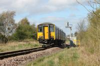 150223 trundles along the single track chord between Bare Lane and Hest Bank with the 1605 Lancaster to Leeds (via Morecambe) service on 12th April 2017. This is one of only two passenger trains to traverse this link on weekdays. The catenary masts of the WCML can just be seen behind the signal. <br><br>[Mark Bartlett&nbsp;12/04/2017]