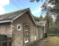 The former station building at Dinnet on 20 April 2017 looking east along the platform towards Aboyne. Note the unusual round window, installed as a replacement for the old station clock during conversion to office accommodation [see image 58970].<br><br>[Andy Furnevel&nbsp;20/04/2017]