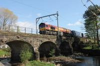 DB 66145, still in EWS livery, crosses the River Wyre at Scorton heading north with a container train on a sunny 22nd April 2017.<br><br>[Mark Bartlett&nbsp;22/04/2017]