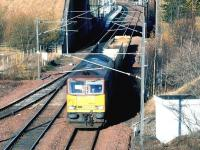 EWS 60029 <I>Clitheroe Castle</I> has just passed Newcraighall station on 23 November 2004 with a short train of empties from the STVA car terminal at Bathgate returning to Washwood Heath.<br><br>[John Furnevel&nbsp;23/11/2004]