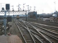 The beginning of the end for the famous signal gantries south of the Joint Station. The new colour light signals were being set up already in Spring 1980 although the power box did not take over until 1981. Aberdeen South Signal Box is in the centre of the photo.<br> The train approaching is an SRPS railtour set destined for Dufftown hauled by 27010 [see image 59220] Members of the Aberdeen University Railway Society joined the train here.<br><br>[Charlie Niven&nbsp;31/05/1980]
