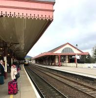 Waiting for a train. Looking along platform 1 at Aviemore station on 26 April 2017. Just arriving from the north is the ScotRail 1551 Inverness - Edinburgh.<br><br>[Andy Furnevel&nbsp;26/04/2017]