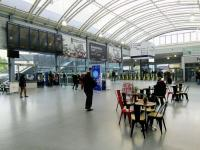 Cafe society: a look across the concourse at Haymarket on 24/04/2017. It's easy to forget that until a few years ago Haymarket's 'circulating area' was the in the original 1842 building which now acts as sort of vestibule. The white building on the other side of the tracks is over 100 years older than that. Easter Dalry House was once a mansion in open countryside ...<br><br>[David Panton&nbsp;24/04/2017]