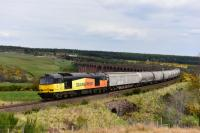 Colas Rail Freight liveried 60096 leaves Culloden Viaduct with the southbound cement empties. One cargo wagon and ten Tarmac cement tankers.<br><br>[John Gray&nbsp;01/05/2017]