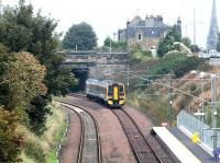 A morning service from Newcraighall has just left Brunstane on 15 October 2002. ScotRail 158717 is about to pass below Milton Road before joining the ECML for the run to Waverley.<br><br>[John Furnevel&nbsp;15/10/2002]