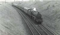 Black 5 45151 with a returning excursion from Ayr Races heading for Glasgow, photographed near Kilbarchan on 27 September 1959. [Ref query 1008]   <br><br>[G H Robin collection by courtesy of the Mitchell Library, Glasgow&nbsp;27/09/1959]
