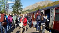 Having drawn forward to allow a ScotRail service to pass, passengers are allowed to stretch their legs at Glenfinnan. The train has its own Souvenir Shop. The station enjoys a burst of activity unrivalled the rest of the day.<br><br>[Beth Crawford&nbsp;02/05/2017]