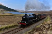 K1 No.62005 hauls * The Great Britain X * up the gradient towards Luib<br> Summit on the way to Kyle of Lochalsh. Loch Gowan is in the background.<br><br>[John Gray&nbsp;06/05/2017]