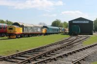 Preserved diesels 37152 and 46035 stand in the Peak Railway sidings at Rowsley alongside the Heritage Shunters Trust stock shed. The Trust has examples of Classes 01, 02, 03, 04, 05, 06, 07, 08, 09 and 14 at Rowsley - a remarkable collection that is well worth a visit, if a little difficult to photograph in cramped surroundings but at least most are now under cover.<br><br>[Mark Bartlett&nbsp;07/05/2017]