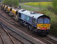 DRS-liveried but Freightliner-owned and branded 66413 draws a Craiginches South - Millerhill ballast out of Inverkeithing Up Loop on 25 April.<br><br>[Bill Roberton 25/04/2017]
