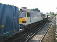 Looking back from a London bound commuter service calling at Redhill on 13 July 2002 as a lengthy train of containers runs south through the station on the centre road. Locomotives 66007 and 92008 <I>Jules Verne</I> are at the head of the train, which is signalled for the Channel Tunnel route via Ashford.<br><br>[Ian Dinmore&nbsp;13/07/2002]