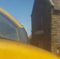 A somewhat unconventional view of St Bees. 37402 seen through the front of a loco-hauled set.<br><br>[John Yellowlees&nbsp;08/05/2017]