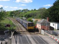 On 22 April 2017, the 13.43 service from Barnstaple to Exeter and Exmouth halts briefly at Crediton signal box to return the single-line token from Eggesford to Crediton to the signaller. The single line from Barnstaple to Crediton - originally engineered for double-track throughout, but never fully doubled - now has just one passenger loop, at Eggesford, where drivers exchange tokens with the signaller from platform cabins, using the 'No Signaller Token Remote' system, which is low-cost but time-consuming.<br><br>[David Spaven&nbsp;22/04/2017]