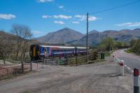 An Oban to Glasgow service heads east over Inverhaggernie Level Crossing No 1, west of Crianlarich. The rear of the train is by the camera.<br><br>[Ewan Crawford&nbsp;05/05/2017]