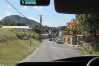 A former level crossing in Sandy Point Town, St Kitts, immediately to the south of the La Vallee limit of rail operations. This view was taken from a bus returning rail passengers to Basseterre to complete the circular trip. The twelve mile disused section of line can be seen at various points from this road along the west coast.<br><br>[Mark Bartlett&nbsp;18/02/2017]
