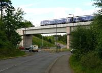 The ScotRail 0924 Edinburgh - Tweedbank crossing Hardengreen Viaduct on 18 May 2017, seen looking south west towards the roundabout along the B6392.<br><br>[John Furnevel&nbsp;18/05/2017]