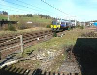 The remains of Beattock station looking north through the Network Rail access gate on 27 March 2017. The approaching train is the 0906 First TransPennine Express Glasgow Central - Manchester Airport.<br><br>[John Furnevel&nbsp;27/03/2017]
