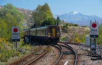 Mallaig bound Sprinter entering Glenfinnan. Guards on the West Highland are often a breed apart and the guard on this train was no exception. Guard, tour guide, entertainer; all handled with good grace.<br><br>[Ewan Crawford&nbsp;03/05/2017]