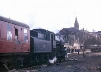 Looking south east towards Alston station on 26 March 1967, with Ivatt 2-6-0 no 43121 at the head of the recently arrived BLS/SLS <i>Scottish Rambler no 6</i>. [See image 35215]<br><br>[Bruce McCartney&nbsp;26/03/1967]