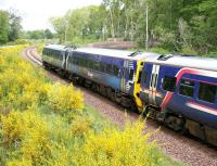 The 0945 Tweedbank - Edinburgh runs through Gore Glen Country Park on 21 May 2017, midway between its scheduled stops at Gorebridge and Newtongrange.<br><br>[John Furnevel&nbsp;21/05/2017]