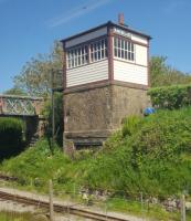Two gauges at Ravenglass: the narrow gauge viewed from a train on the standard gauge railway. The signal box, although in good condition, no longer controls trains.<br><br>[John Yellowlees&nbsp;08/04/2017]