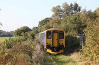 A DMU special approaching Teignbridge Level Crossing on the freight only Heathfield Branch, north west of Newton Abbott, on 2 October 2015. [Ref query 1026]<br><br>[Ian Dinmore&nbsp;02/10/2015]