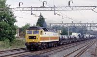 Class 47 in 'Police' livery on a northbound car-train at Headstone Lane. As I took this picture, with the train approaching, the 47 was making such a racket I thought it was going to collapse into pieces !<br><br>[Bernard Holland&nbsp;04/07/2003]