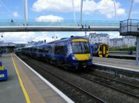 An Aberdeen to Glasgow service pulls out of Stirling on 18/05/2017. A 158<br> is stabled at Platform 8.<br><br>[David Panton&nbsp;18/05/2017]