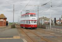 Balloon 701, in eye catching red and white livery, uses the crossover at Cabin to regain the southbound line after an Easter weekend heritage trip from Pleasure Beach. The current paint scheme is certainly an improvement on that previously carried [See image 42861].<br><br>[Mark Bartlett&nbsp;17/04/2017]