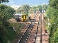 A train off the Bathgate branch about to join the main line at Newbridge Junction on 24 September 2006 with a through service to Newcraighall.<br><br>[John Furnevel&nbsp;24/09/2006]