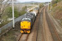 DRS 37609 brings up the rear of a two flask train from Heysham to Sellafield on 5th April 2017. The train is running along the chord from Bare Lane approaching Hest Bank with classmate 37218 leading. <br><br>[Mark Bartlett&nbsp;05/04/2017]