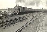 A Milngavie bound train runs through Kelvinhaugh Junction on 28 May 1957 behind Eastfield shed's ex-NBR C16 4-4-2T no 67500.<br><br>[G H Robin collection by courtesy of the Mitchell Library, Glasgow&nbsp;28/05/1957]