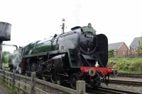 BR Standard 9F 2-10-0 92214 taking water at Loughborough Central on 6th May 2017.<br><br>[Peter Todd&nbsp;06/05/2017]