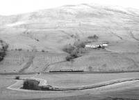 An unidentified 3-car DMU passing Corsencon Farm south of New Cumnock. View north over the River Nith from a viewpoint alongside the A76. Thought to have been taken in September 1980.<br><br>[John Furnevel&nbsp;27/09/1980]
