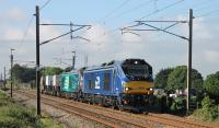 <I>Fresh from the boat</I>. Newly imported DRS 68026 was used on the Crewe Sellafield flask train on Saturday 3rd June 2017. Paired with 68001 <I>Evolution</I> the pair are seen heading north at Brock. 68026 is intended for TPE passenger services and the different (temporary) livery is very noticeable.<br><br>[Mark Bartlett&nbsp;03/06/2017]