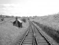 The headshunt at Greenlaw looking east towards Duns, seen from the cab of the locomotive recently arrived with the last branch freight from St Boswells on 16 July 1965. For the same view 47 years later [see image 40876].<br><br>[Bruce McCartney&nbsp;16/07/1965]