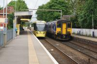 Tram and train both with their next stop at Altrincham, call at Navigation Road on 19 May 2017. The Metrolink tram will terminate there but the Northern Class 150/2 is heading to Chester.<br><br>[John McIntyre&nbsp;19/05/2017]