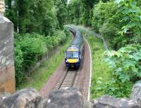 Approaching the end of the single line section from Fushiebridge at Kings Gate on 28 May 2017 is the 6-car 0845 Tweedbank - Edinburgh.<br><br>[John Furnevel&nbsp;28/05/2017]